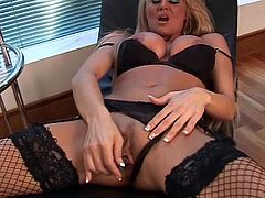 Staggering milf sure looks hot in that black lingerie and stroking her pink pussy with such stiff toys