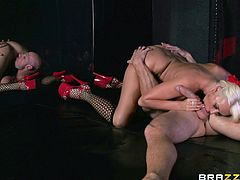 Have fun watching this blonde cougar, with immense fake tits wearing fishnet stockings, while she goes hardcore with a horny fellow.