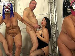 All these slaves will do absolutely anything for this gorgeous goddess. That includes entertaining her with humiliating sex. The gimps pound each other mercilessly as the mistress watches and gets fucked by a slave from behind. There's cock sucking and boob rubbing galore with these masked sluts and slaves.