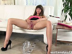 Susana is a slutty babe and she doesn't hide it. See her showing off her twat and asshole on the sofa. She spreads her legs and sticks those toys into all of her holes.