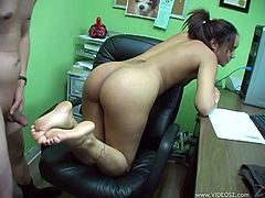 A petite girl takes off her clothes in an office. Some guy comes up to Jaslin. The girl gives a footjob and then he cums on her right armpit.