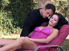 A sexy brunette is relaxing on a lounge chair in the garden. Her lover uncovers her big breasts to squeeze and suck them. Watch the horny bitch giving in to her lusty desires and doing a foot job. The atmosphere gets really intense as the guy approaches to lick the juicy shaved pussy. Click to watch!