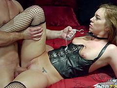 Lovely Maddy Oreilly on a leash makes guys every sexual fantasy a reality. Charming brown haired chick in leather corset and mesh stockings sucks his cock deep before he inserts his beefy dick in her pink vagina.