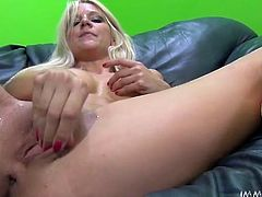 This unbelievably horny blondie knows how to give a good blowjob. She sucks her lover's dick like a seasoned pro. Then she spreads her legs wide indicating how bad she wants her kinky lover to drive his pecker into her tight pussy.