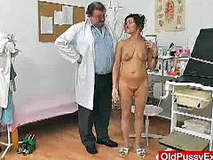 If you like mature redheads make sure you don't miss this one. Watch as she spreads legs on the chair before the doctor using his speculum to stretch her old cunt.