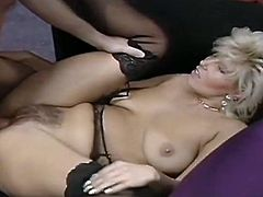 Curvy mom with appetizing tits and round booty is having passionate sex on a couch. She is hammered deep and rough in her pussy hole in a missionary position. Then, she is banged doggy style.