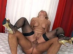 Skanky blonde granny is wearing nylon stockings while having kinky fuck session. She humps on top of solid pecker taking it deep up her fuck hole.
