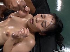The salacious Ruka Kanae is covered with body oil and she enjoys being drilled by two horny dudes. They fuck her hard and splash their sperm all over her.
