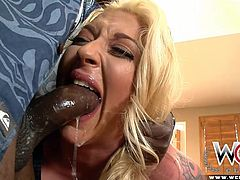 This sexy blonde slut spreads her ass cheeks nice and wide and sticks a dildo in her tight butthole to loosen it up for her man's black dick. She deepthroats his big dick and slobbers and spits all over it.
