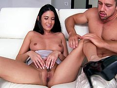 Sizzling Nikki Daniels rubs her pussy and rides a large dick