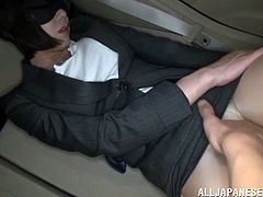 Sexy Japanese milf wearing pantyhose and thong is getting naughty with a dude in a car. She moves her legs wide apart and lets the dude rub her twat with massage dildo.