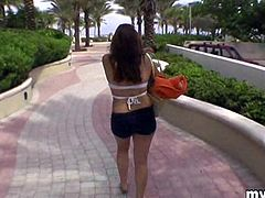 A horny brunette girl flashes her boobs on a beach in a reality video. This playful girl also gives a handjob to a guy in POV style clip.