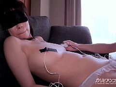 This Japanese babe has a blindfold on and toys attached to her nipples. A guy inserts a vibrator in her hairy pussy and puts some sort of brush over her clitoris.