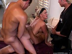 Sexy amateur MILF gets fucked hard by two big cocks while her cuckold husband sits right next to her and watches her gobble those cocks.