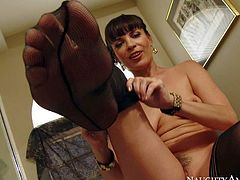 MILF pornstar Dana Dearmond in black stockings displays her natural tits and her wonderful thick bare ass. She spreads her buttocks and bends over in front of obedient guy. He make him stick his dick in her asshole. Dana Dearmond loves getting her anus licked.