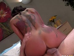 Breath taking tattooed hoochie hops on meaty pole and her jaw dropping big assets bounce in front of his face in steamy Brazzers sex tube video.