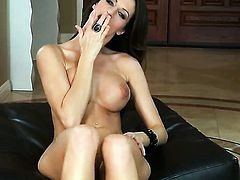 Kortney Kane with juicy jugs and clean pussy has fire in her eyes as she plays with herself