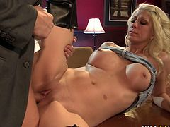 Attractive blonde Jazy Berlin gives her head to porn actor Rocco Reed