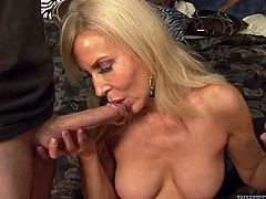 Voluptuous blonde mom with big boobs sits down on her knees while sucking hard dick. She then fucks in a missionary position.
