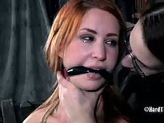 Claire Adams is a hot femdom slut and she loves to be in the control of the situation. Watch as she gets her game on and starts to torture her redheaded slave.