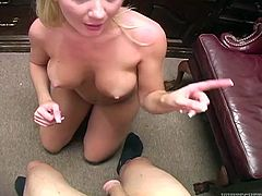 Hot looking blonde chick with fine tits sits on her knees biting poor guy's dick. Mistress bites dude's saggy balls and starts feverishly sucking his boner.