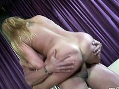 Horny blonde Alanah Rae kneels in front of a man and sucks his wang. Then they bang in the standing, the reverse cowgirl adn other poses, and Alanah big fake tits bounce up and down.