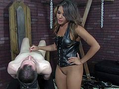 Exotic pantyless domina Mena Li in tight black leather corset shows off her thick ass as she smothers her naked slave boy. Dude finds his nose between her butt cheeks and between her pussy lips as she rides his face.