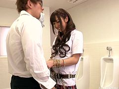 Get excited by watching this long haired brunette, with natural boobs wearing a miniskirt, while she gets drilled hard in a public bathroom.