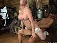 Provocative bosomy slut in white stockings hops on meaty dick reverse and face to face. Her massive fake boobs bounce like crazy balls.