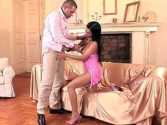 Alluring brunette girl, wearing a minidress and high heels, gives a nice blowjob to a guy. Then she lets him fuck her butt from behind and gets her amazing big tits covered with cum.
