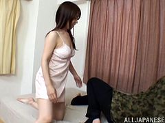 Japanese slut Honami Uehara is trying to satisfy her man. She pleases him with a blowjob, then allows the dude to play with her natural tits.