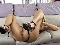 The amazingly sexy blonde Antonia wears her sexy black lingerie as she fingers her hot pierced pussy and her tight little asshole.