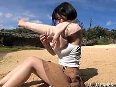 Press play on this amazing solo scene outdoors where this sexy Asian babe shows off her big natural breasts before she blows a guy.