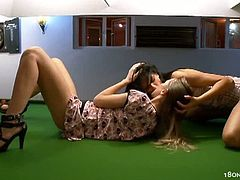 Ivana and Mia kiss each other on a pool table, strip and go wild. After licking and fingering their pussies, they mimic normal sex from the doggy style position.