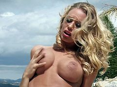 Take a look at this great outdoors scene where the busty blonde Nicole Aniston is fucked by the pool by a guy with a large cock.