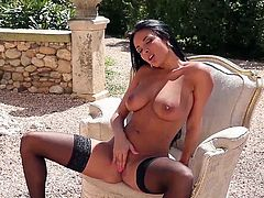 The sexy brunette Anissa Kate fingers her perfect pussy out in the sun while she wears some sexy stockings and high heels.