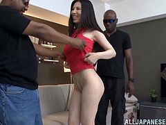 Take a look at this hardcore interracial scene where the sexy Asami Ogawa is fucked by two guys in a threesome after showing off her body.