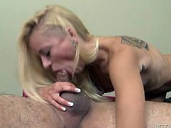 Tattooed blonde with small tits deepthroats her lover's dick