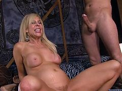 Voluptuous blonde mom fucks dirty in gangbang. She rides big dick on top before getting fucked in a doggy position. Check out this steamy porn video.