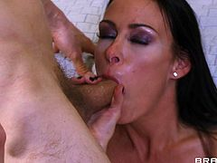 Captivating brunette Vanilla Deville, wearing stockings, is having MMF sex with Erik Everhard and Johnny Castle. The dudes make Vanilla suck their wangs and fuck her hot shaved cunt by turns.