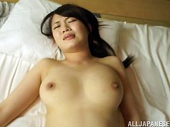 A pretty, young, Asian pornstar with big, natural tits and a hot ass enjoys a mind-blowing missionary style fuck. Hear her scream with pleasure now!