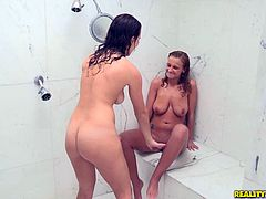 Two well-endowed lesbians lick each other's coochies in the shower