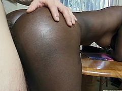This chocolate whore loves the rough treatment. Horny dude bends her over and fucks her tight snatch from behind. Then she rides his swollen cock in cowgirl position.
