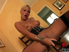 This smoking hot blonde with nicely shaped booty does have an addiction to dark meat. She loves her boyfriend just as much as she loves herself. She asks him to fuck her tight pussy with huge black dildo and he wastes no time to do so.