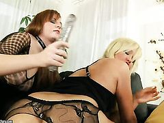 Blonde with gigantic hooters is in the mood for lesbian sex and gives it to Lana Blond