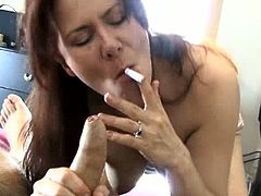 Mina is an amateur smoker and cock-sucker. She does both in this video. She only takes cock out of her mouth if she wants to smoke some more. She gobbles on it.