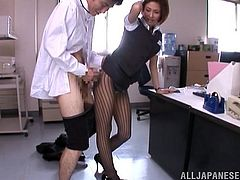 Sexy Japanese Emily Takahash gets naught in the office wearing her sexy pantyhose and her lucky coworker gets an amazing footjob.