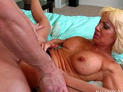Mature slut Tara Holiday with big fake tits is his best buddys horny as hell mother. She seduces him into fucking and enjoys his young hard dick in her many times used loose pussy.