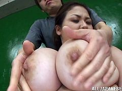 Spellbinding black-haired enchantress sits on the couch letting horny dude paw her huge natural boobs. He squeezes and massages them before getting awesome blowjob.