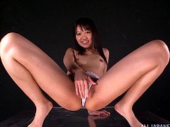 Sexy Japanese girl Kotomi Asakura is down for some hot vibrator action and ends up squirting all over the camera and her glass dildo.